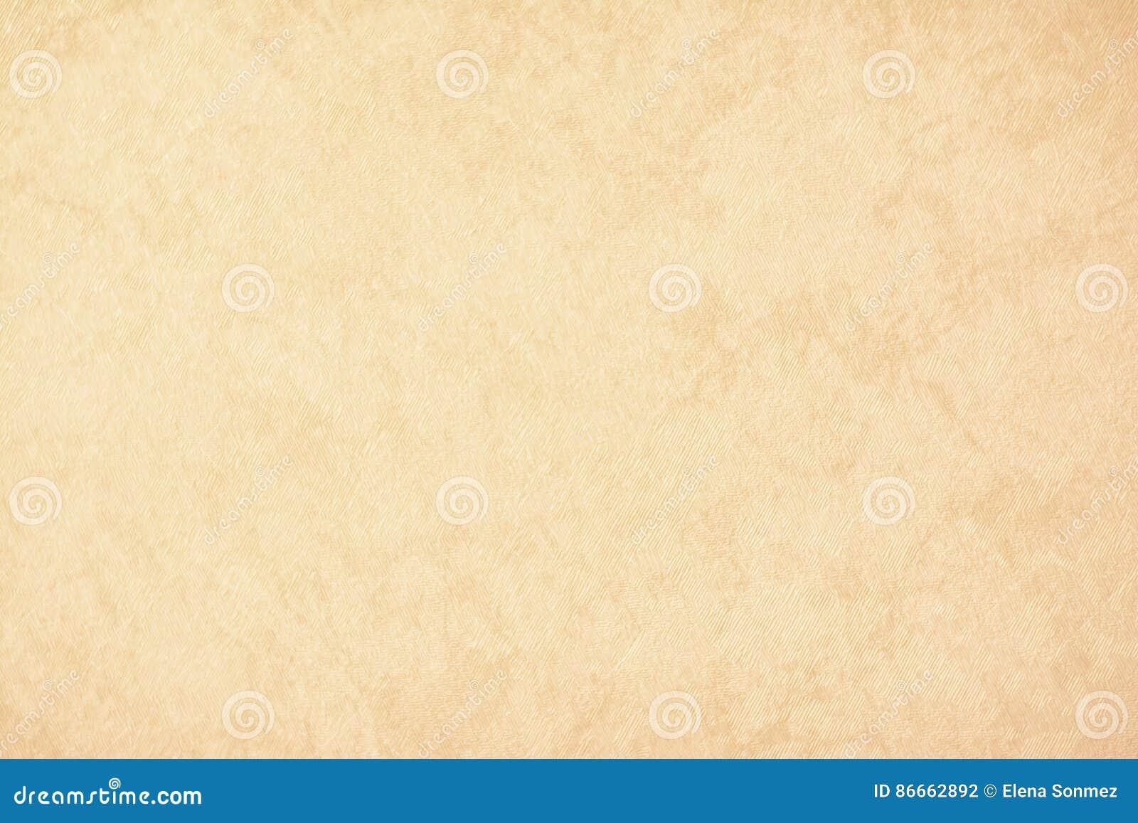 Guld- texturbakgrundspapper i gul tappningkräm eller beige färg, pergamentpapper, abstrakt pastellfärgad guld- lutning