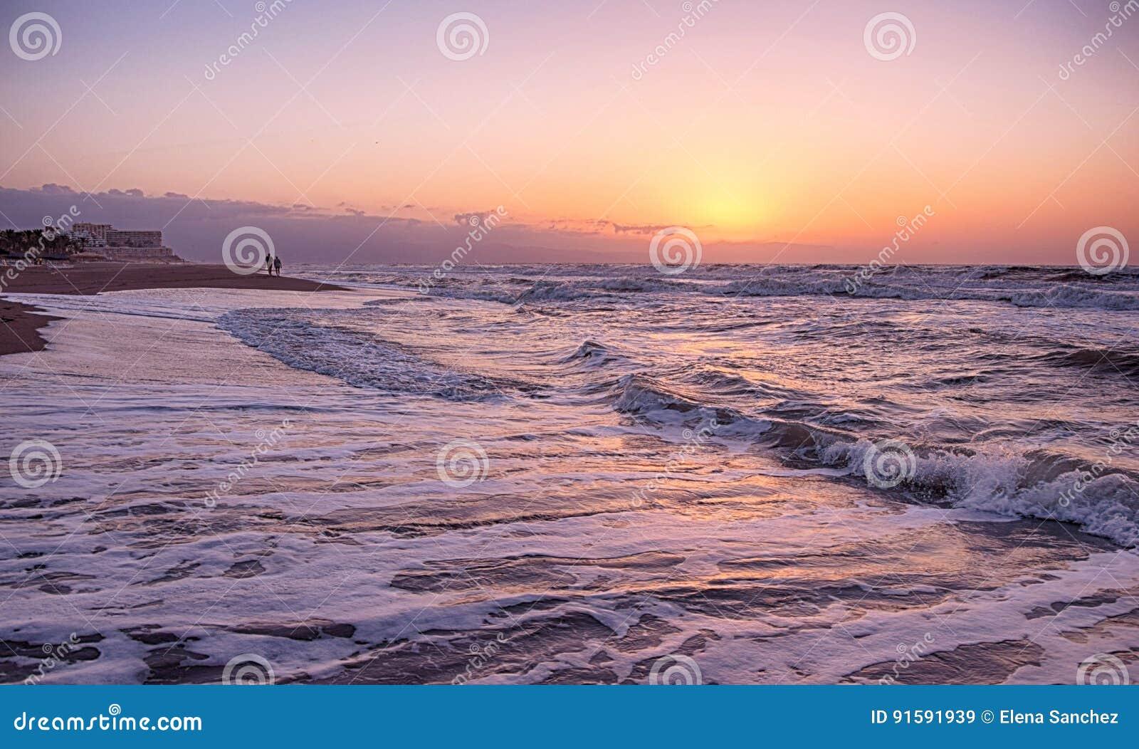 Guld- timme på stranden