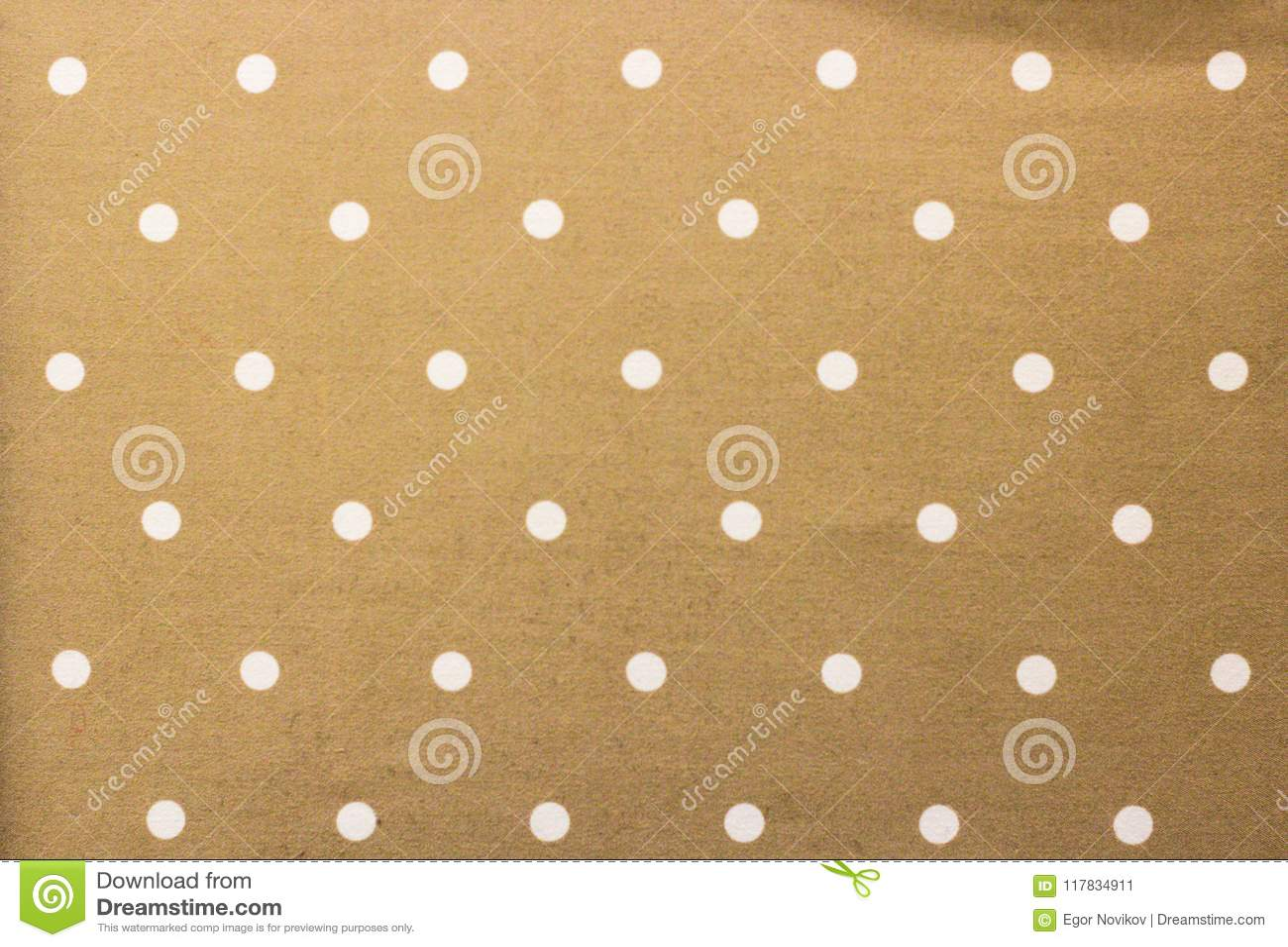 Guld- tyg och en vit mycket liten prickbakgrund