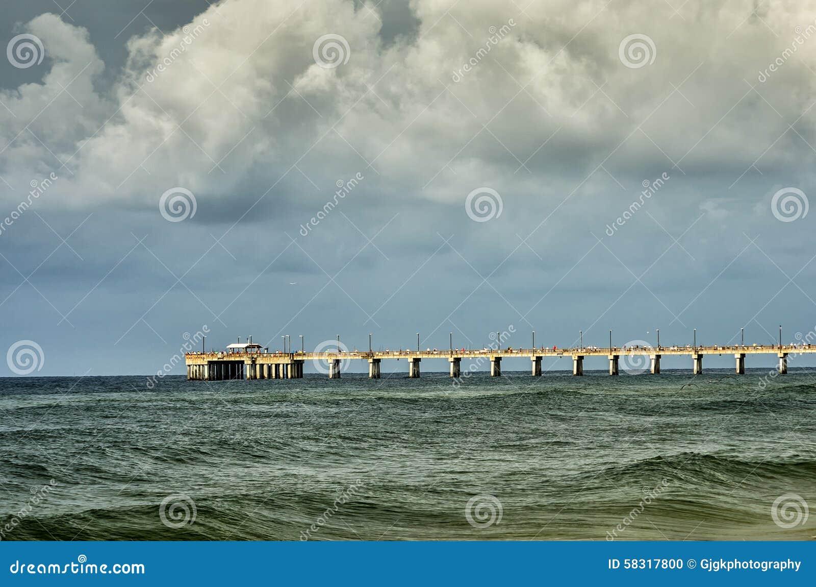 Gulf shores al fishing pier stock photo image 58317800 for Pier fishing gulf shores al