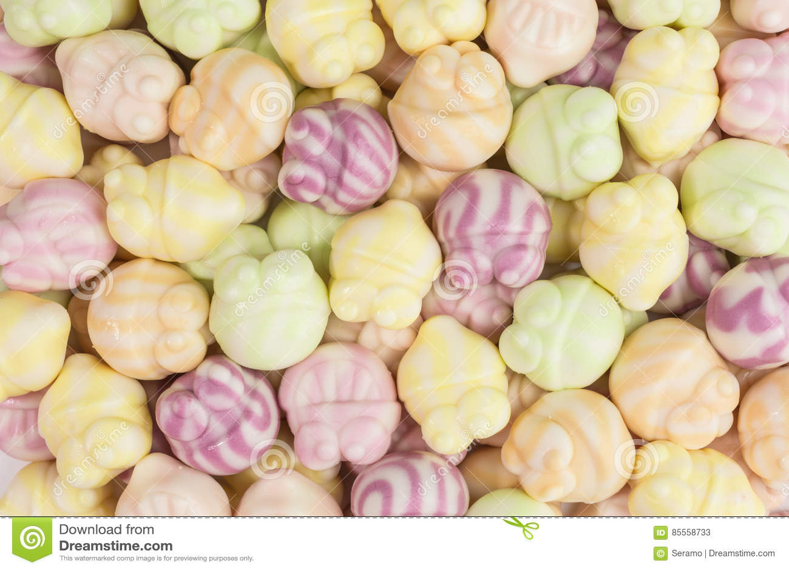 Gummiartiger Süßigkeitshintergrund des Joghurts