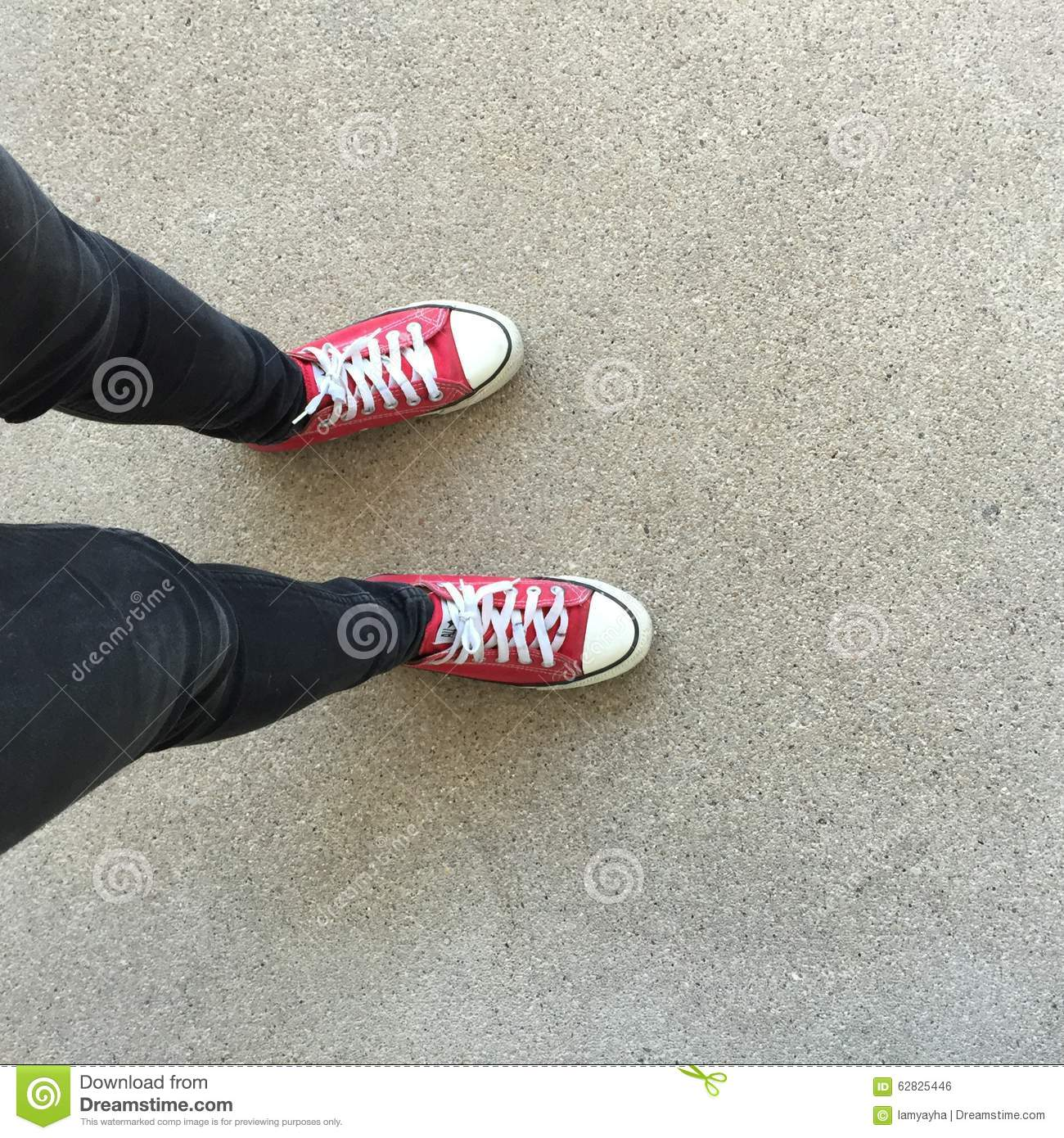Gumshoes on urban grunge background. Image of legs in boots on city street. Feet shoes walking in outdoor. Youth Selphie Modern hi