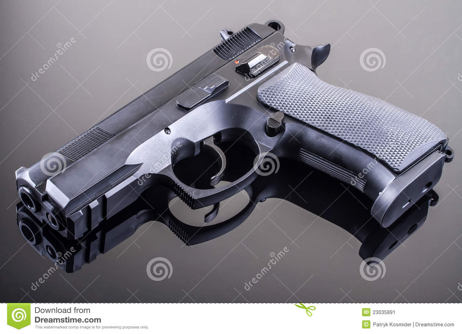 Gun On Glass Table Stock Image - Image: 23035891