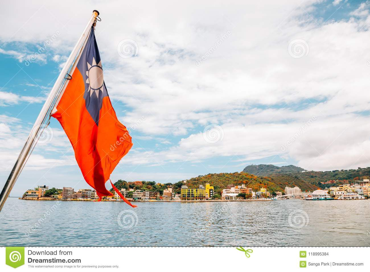 Gushan harbor and Taiwan national flag view from ship going to Cijin island in Kaohsiung, Taiwan