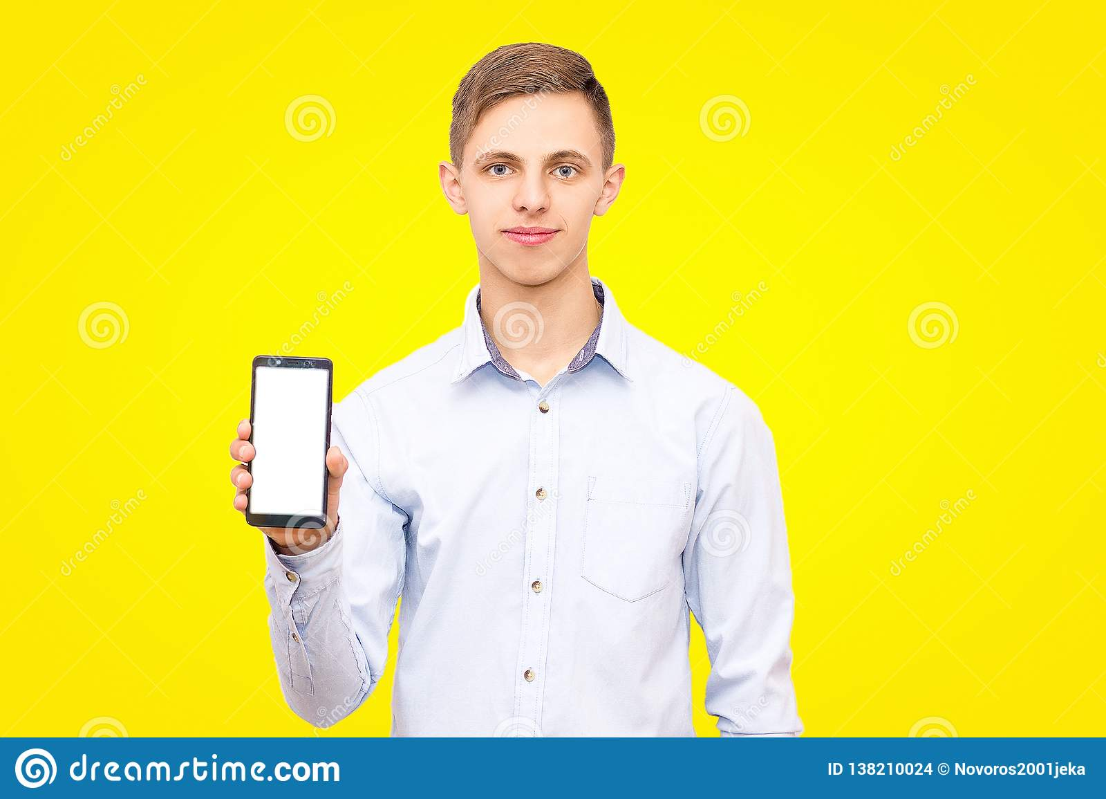 The guy in the blue shirt advertises the phone isolated on a yellow background