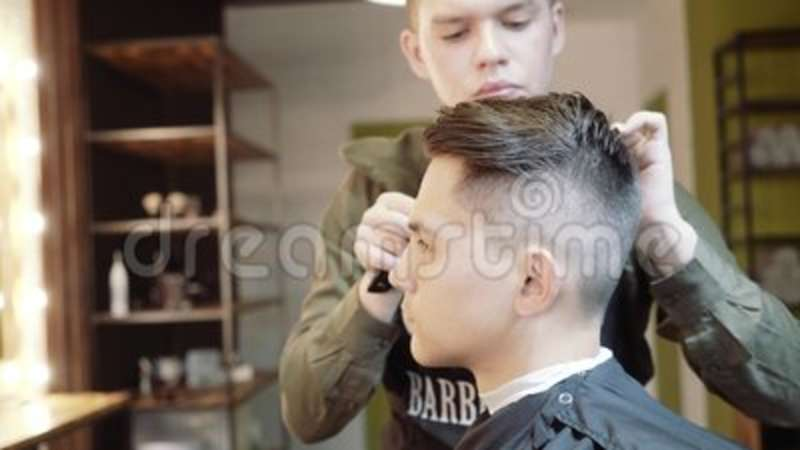 The Guy Does Hair Styling After Haircuts Barbershop Stock Footage