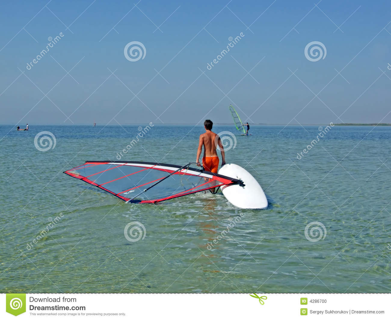 Guy drags the windsurf