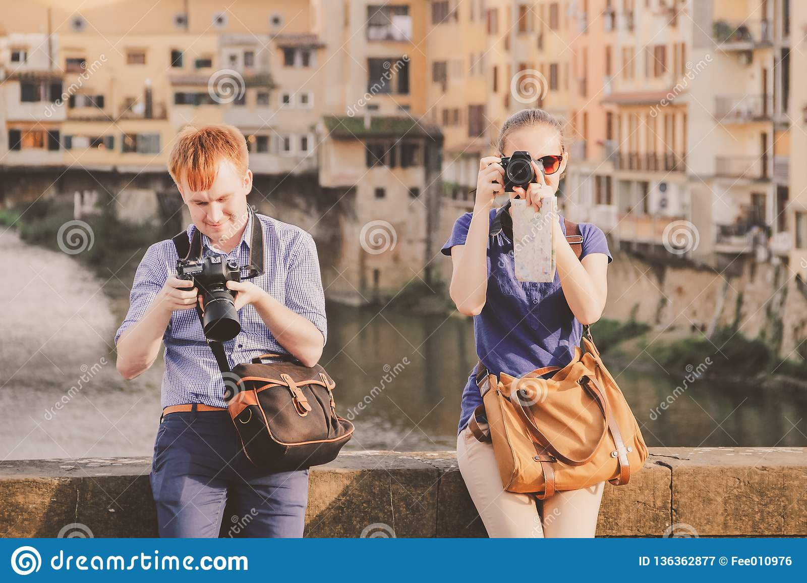 Camera A Ponte.Guy And Girl On Bridge In Front Of Ponte Vecchio Florence Stock