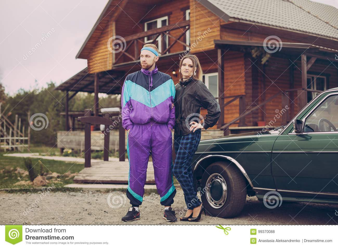Guy And Girl In Clothes Of The Nineties, Next To The Old Car Stock ...