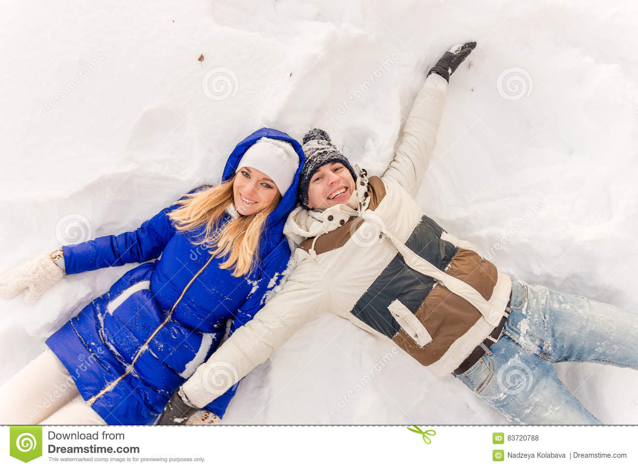 The Guy And The Girl Have A Rest In The Winter Woods. Stock Photo