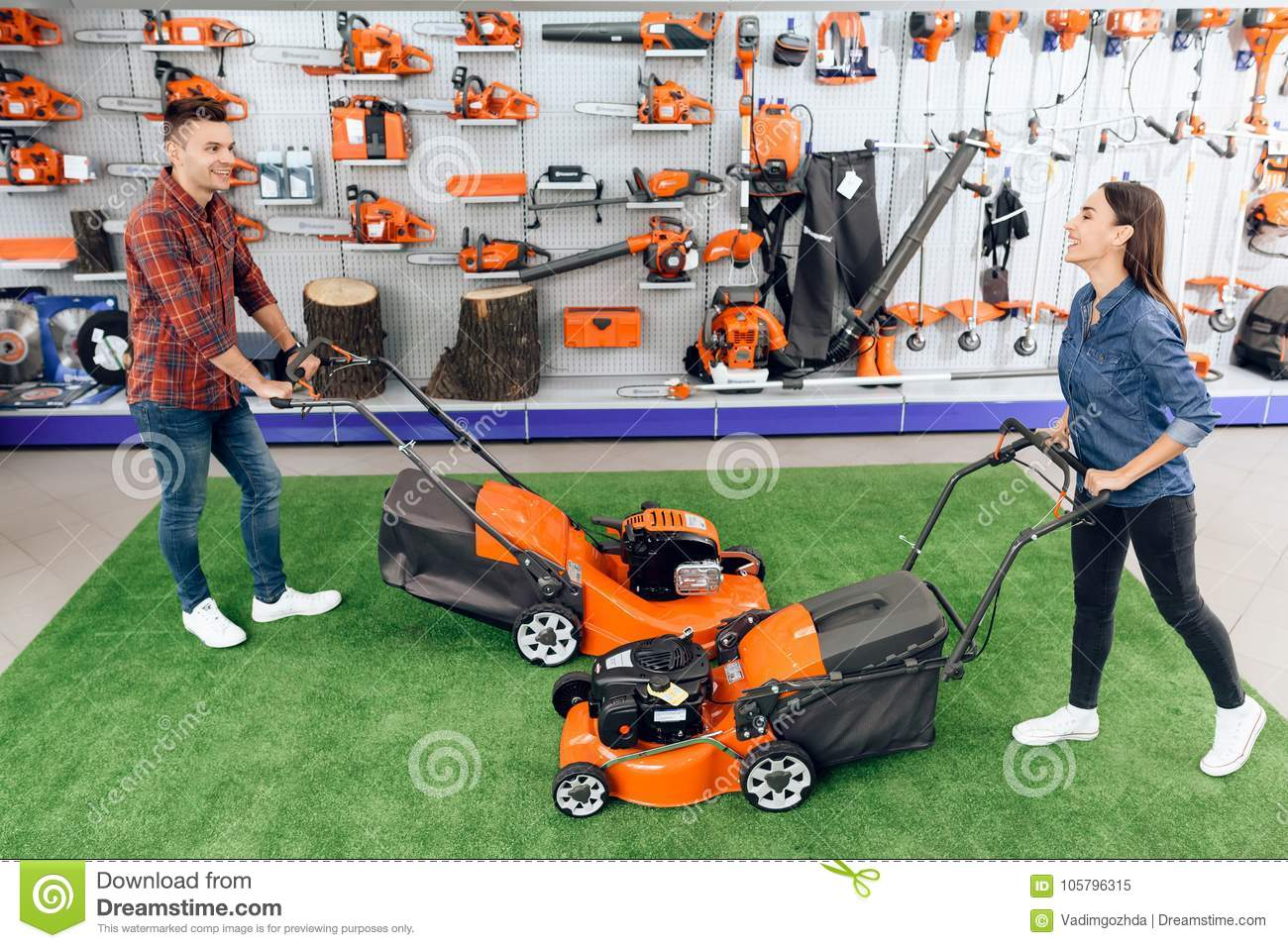 Download A Guy And A Girl Are Posing On The Camera With A Lawn Mower. Stock Image - Image of couple, shopper: 105796315