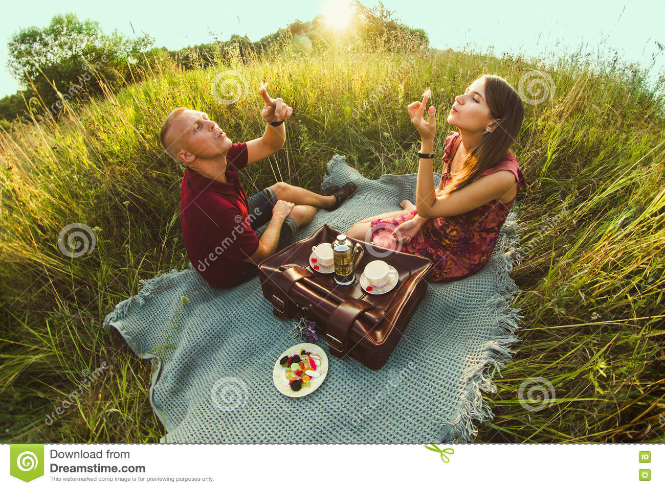 Guy with a girl in summer on the grass