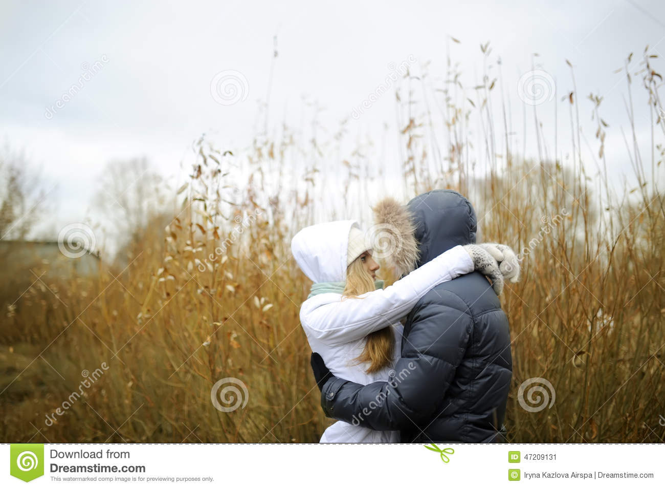 The guy and the girl walk in the autumn park