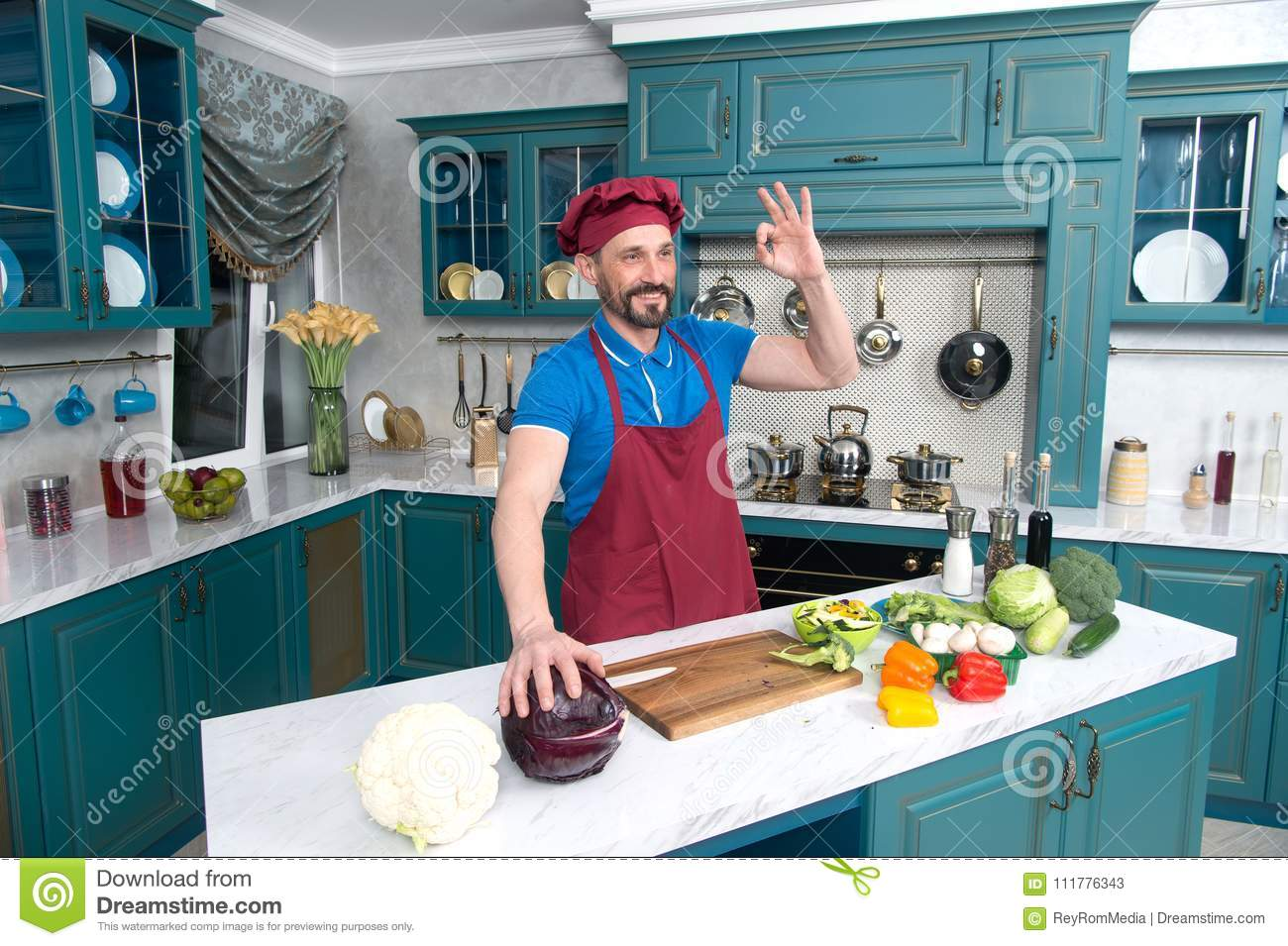 Guy gives OKey and hold red cabbage. Chef ok before cooking vegetables at kitchen.