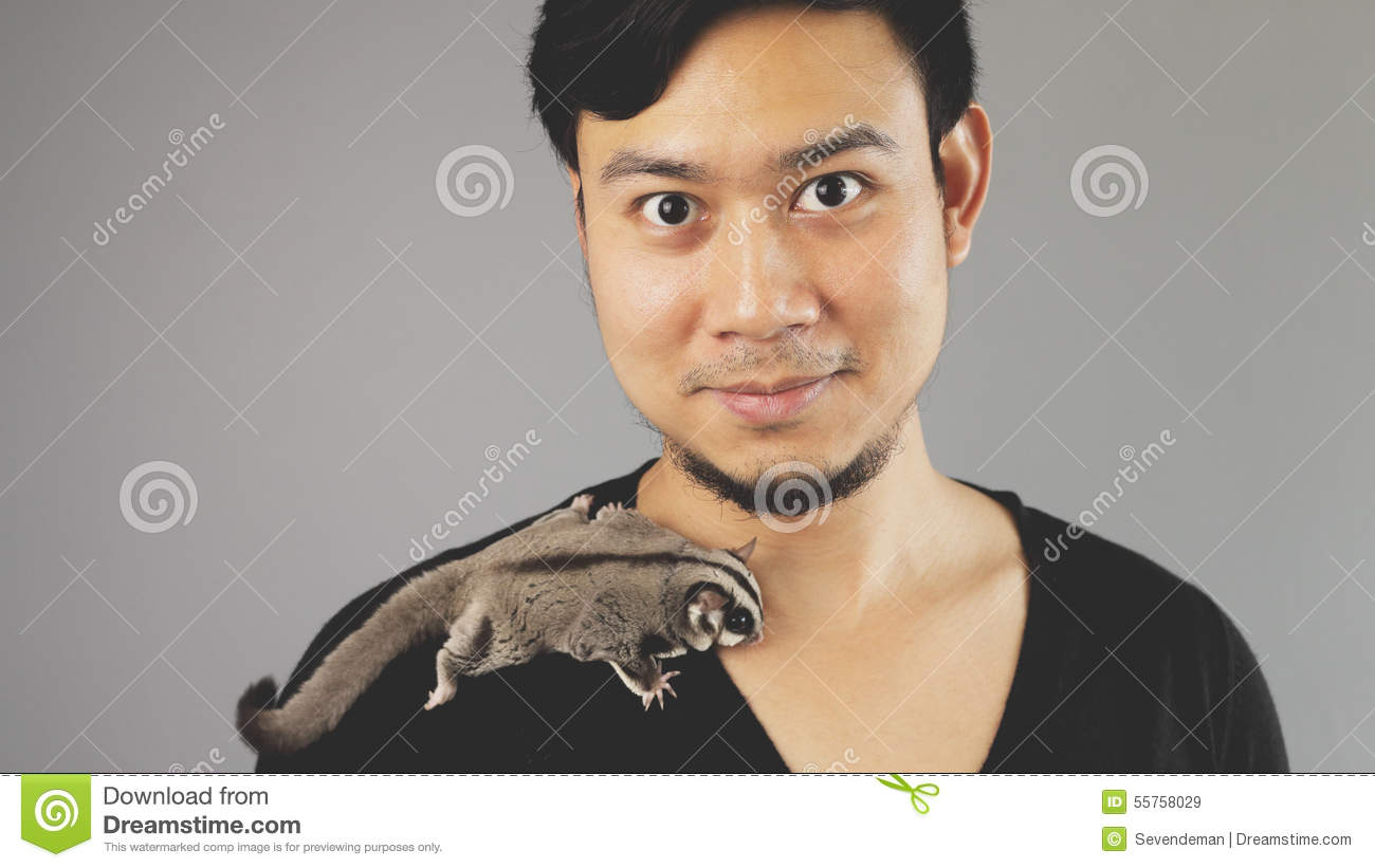 A guy with his exotic pet.
