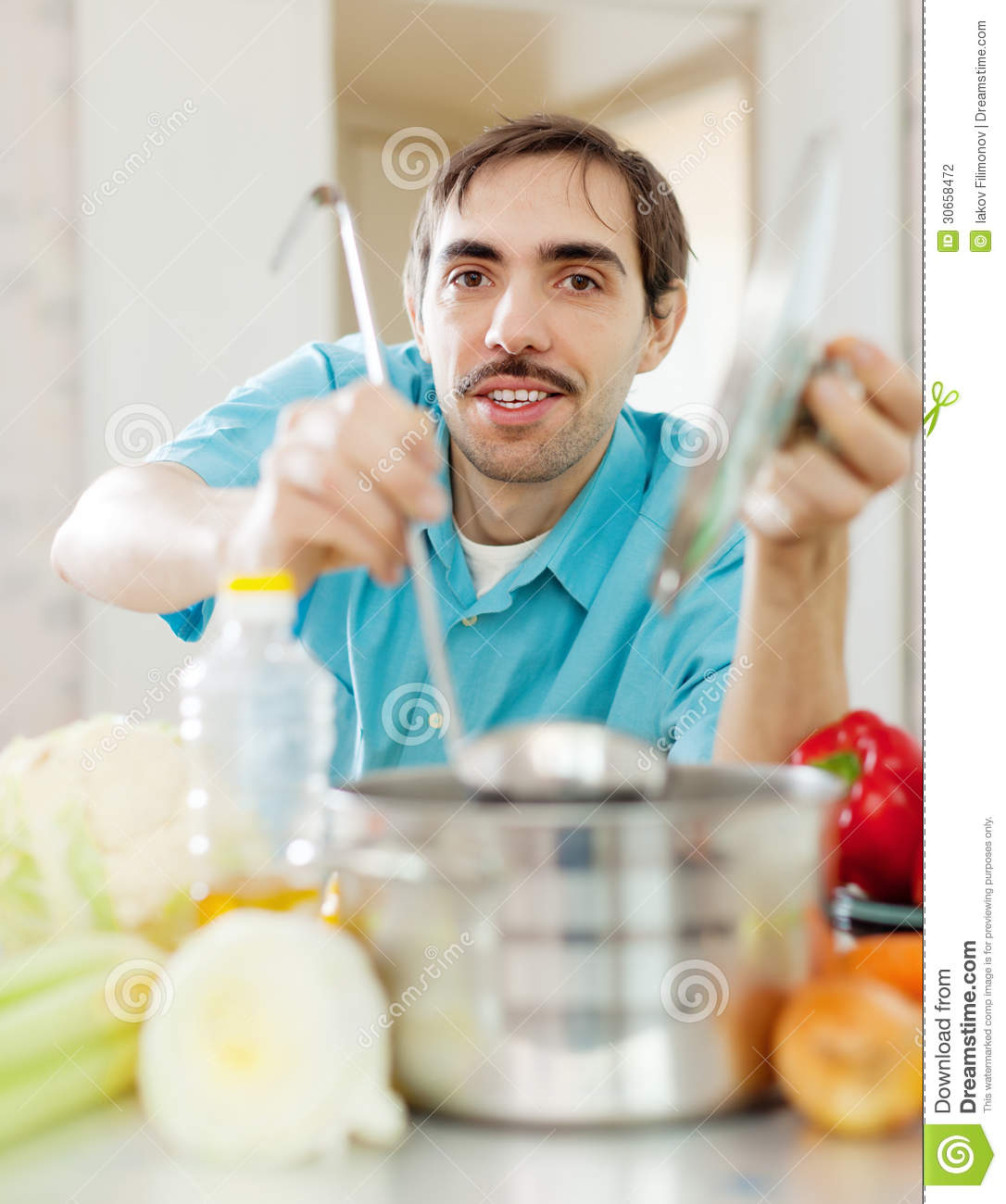 Guy With Ladle Cooking Vegetables Soup At Kitchen Stock Photo ...