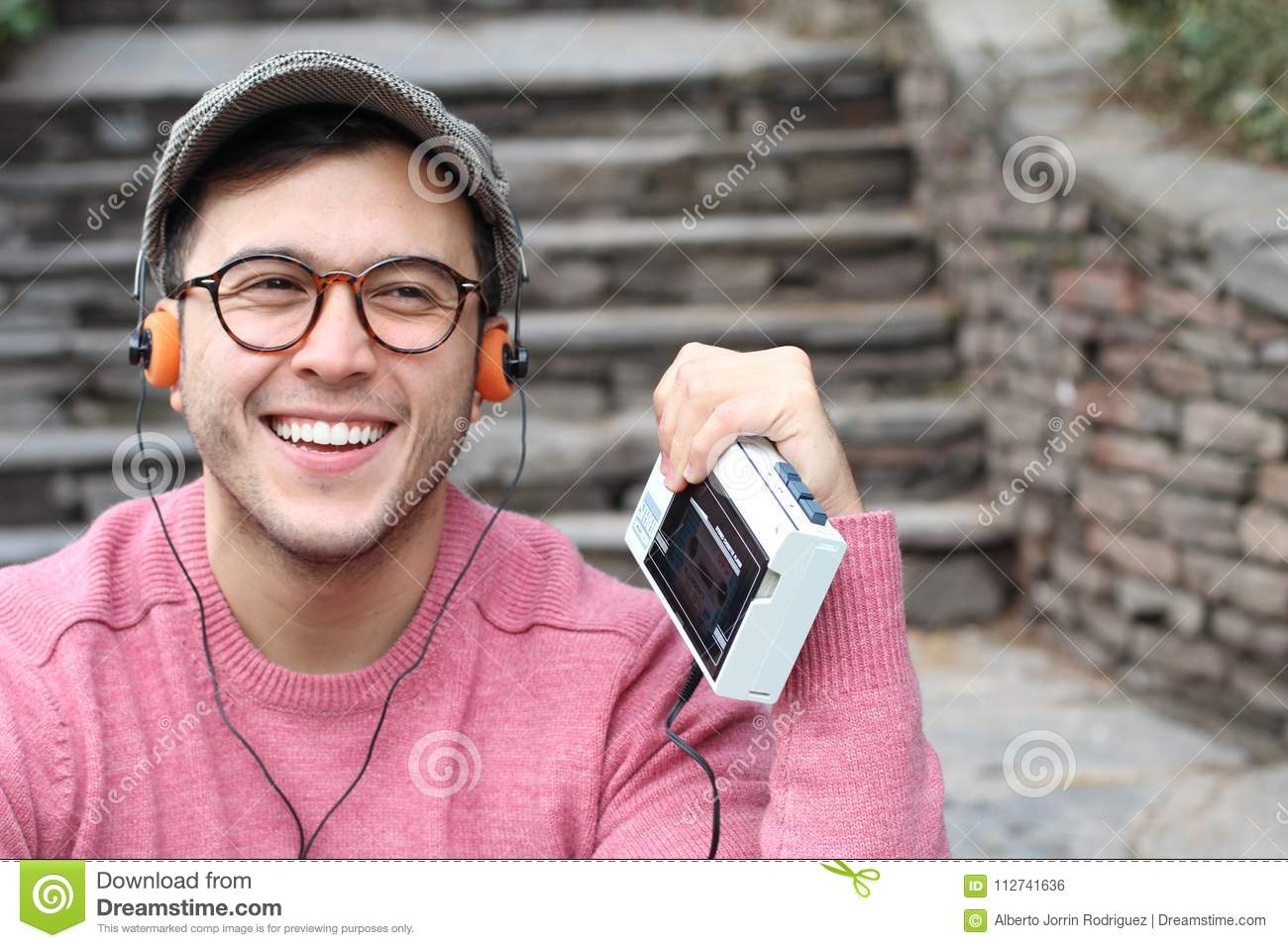 Guy listening to Stereo cassette Walkman in the 80s or the 90s
