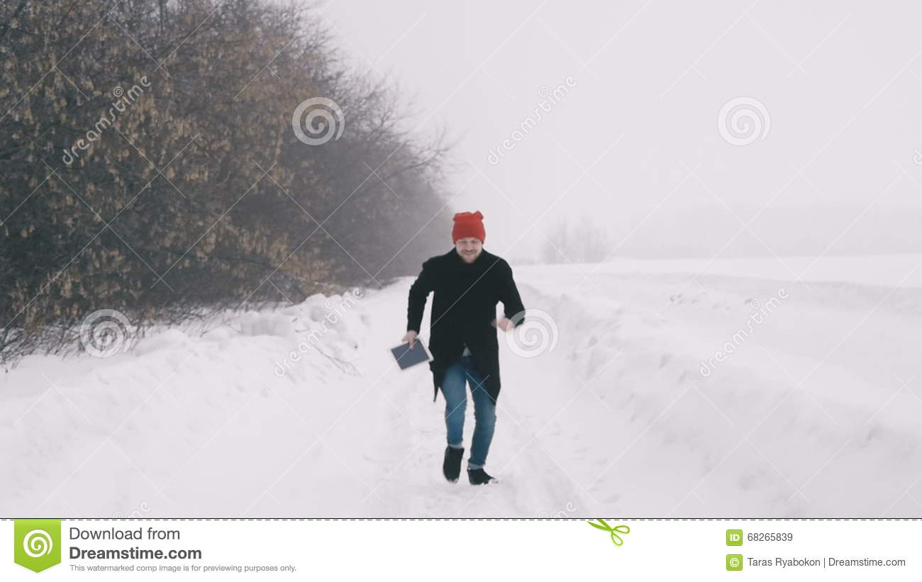 The Guy Running Through The Snow  Slow Motion Stock Video - Video of