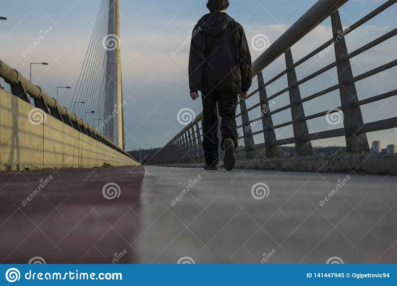 Guy walking on ada bridge in belgrade