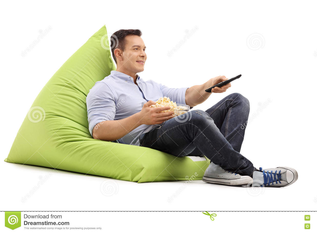 Guy Watching Tv Seated On A Beanbag Stock Photo Image