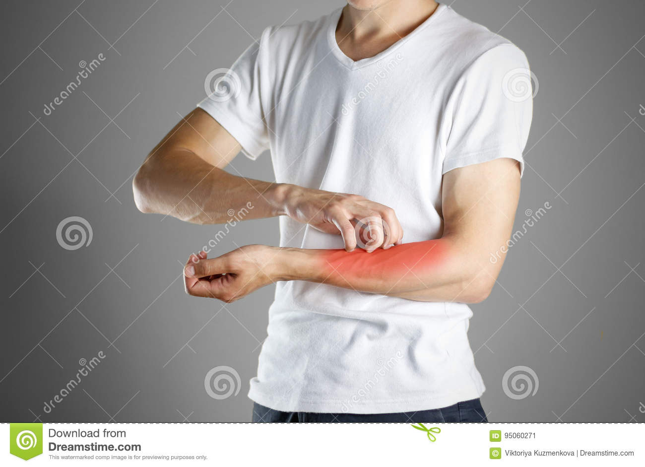 Guy in white shirt scratching his arm. Scabies. Scratch the hand