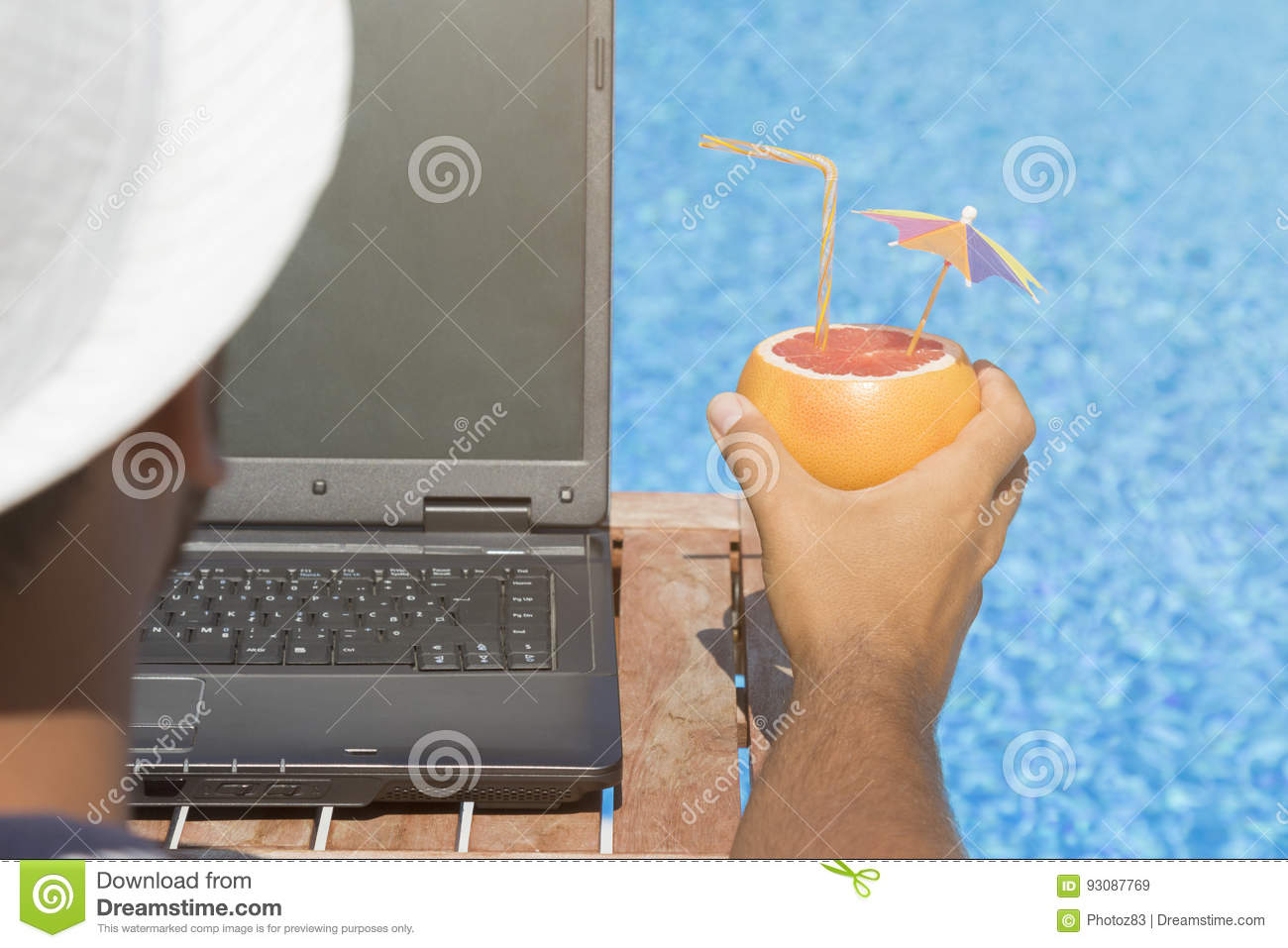 Guy working on laptop and enjoying his summer vacation