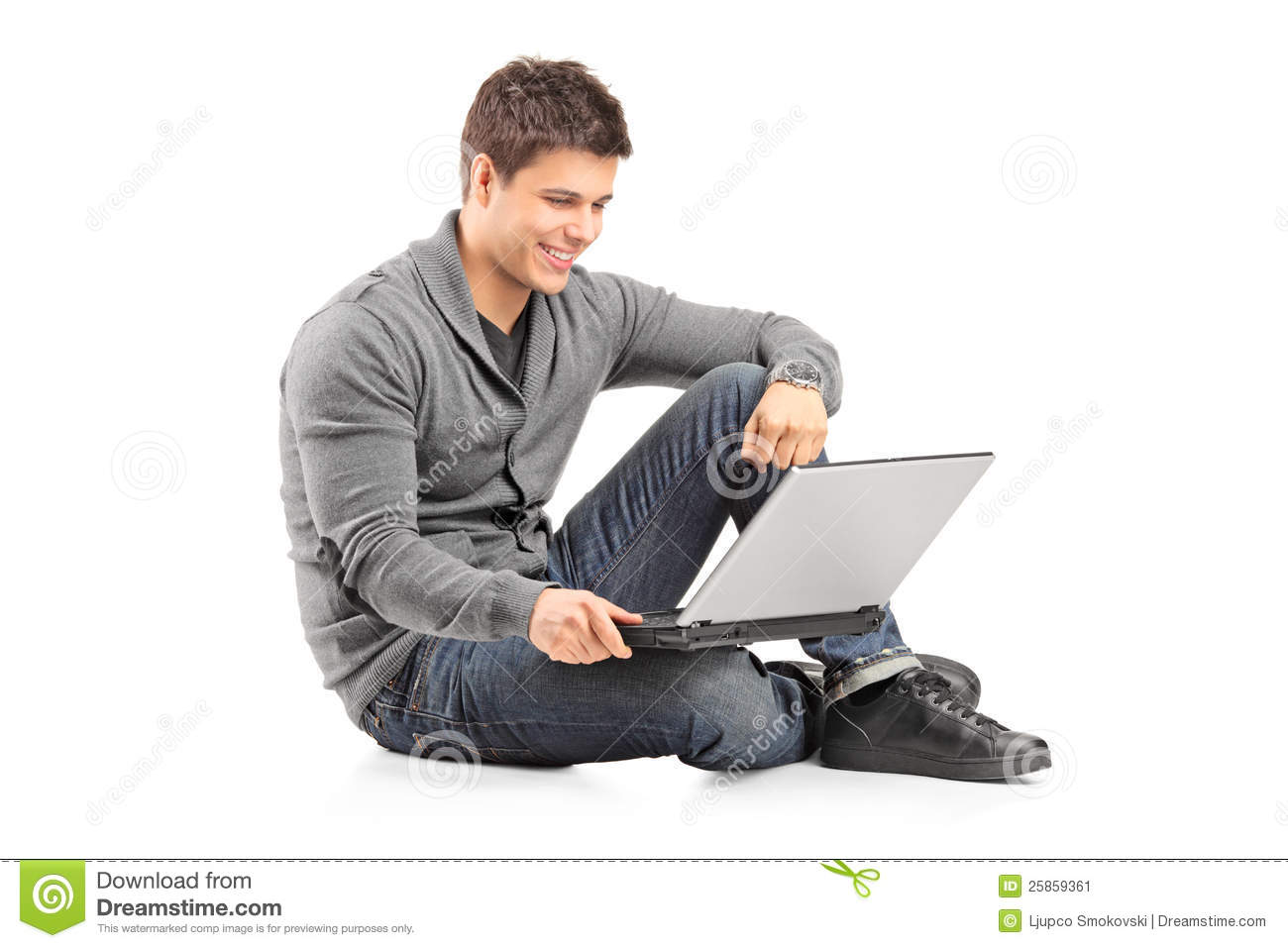 Guy Working On A Laptop And Sitting On The Floor Stock