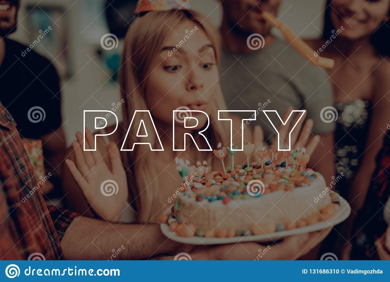 Tremendous Guys Having Fun Birthday Girl Blows Out Candles Stock Photo Funny Birthday Cards Online Alyptdamsfinfo