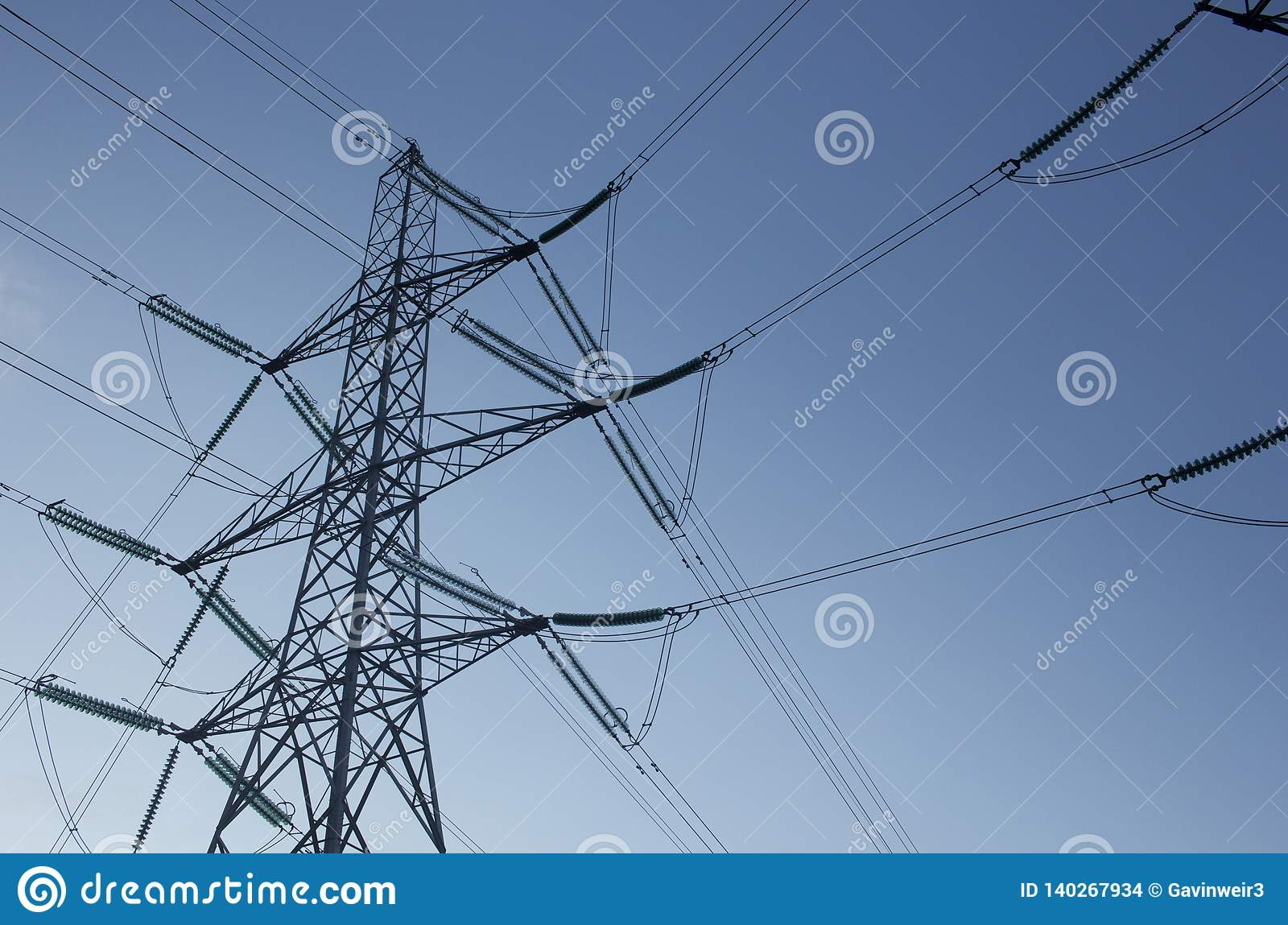 Power supply pylons against a blue sky