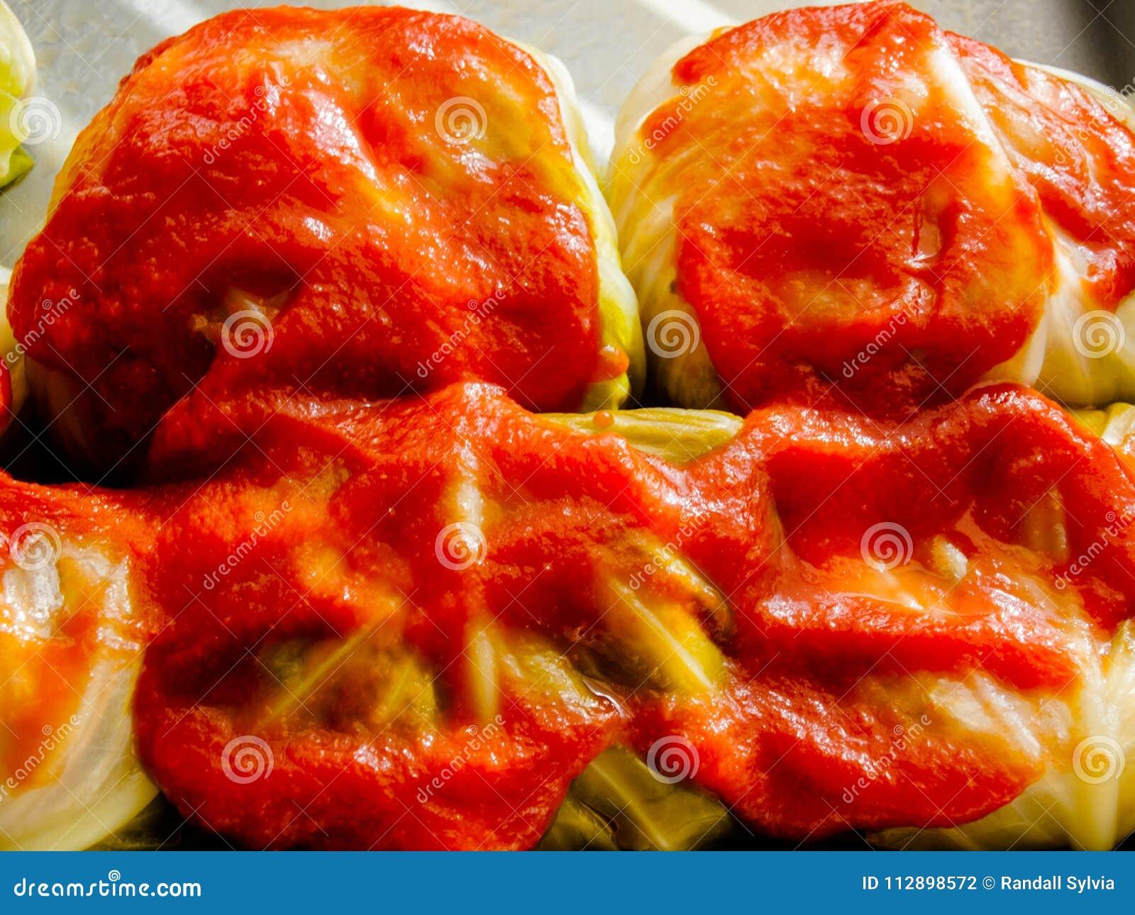 Gwumkies en cierre de la salsa encima de listo para el horno