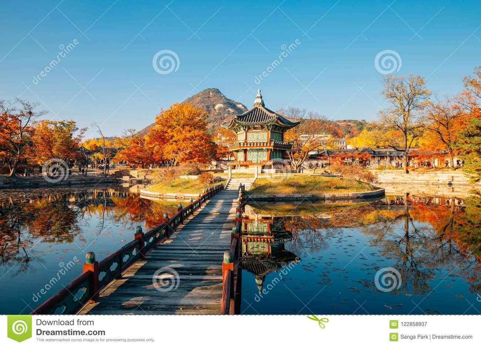 Gyeongbokgung Palace Hyangwonjeong with autumn maple in Seoul, Korea