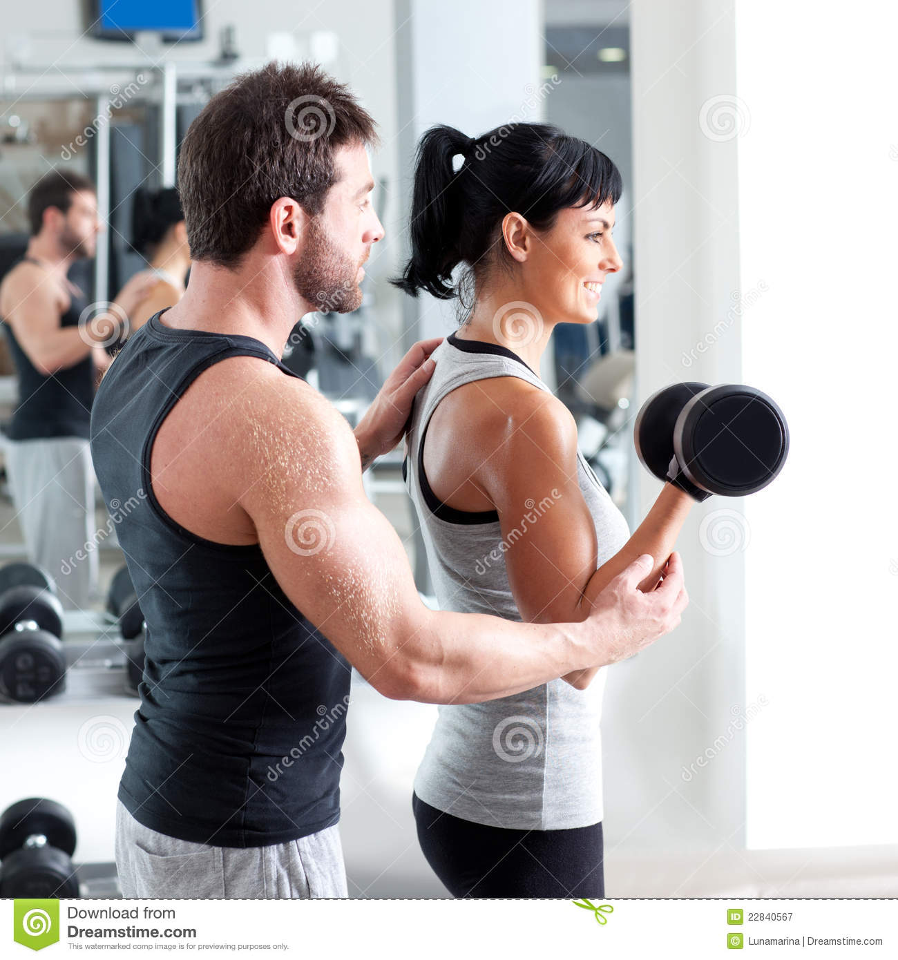 Gym Woman Personal Trainer With Weight Training Stock