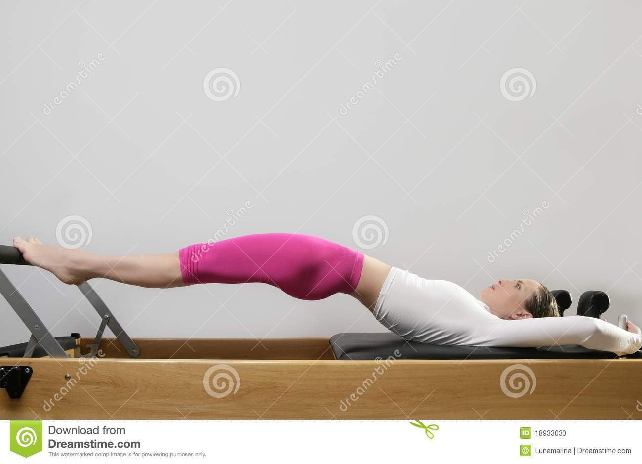 Gym woman pilates stretching sport in reformer bed stock for Gimnasio pilates