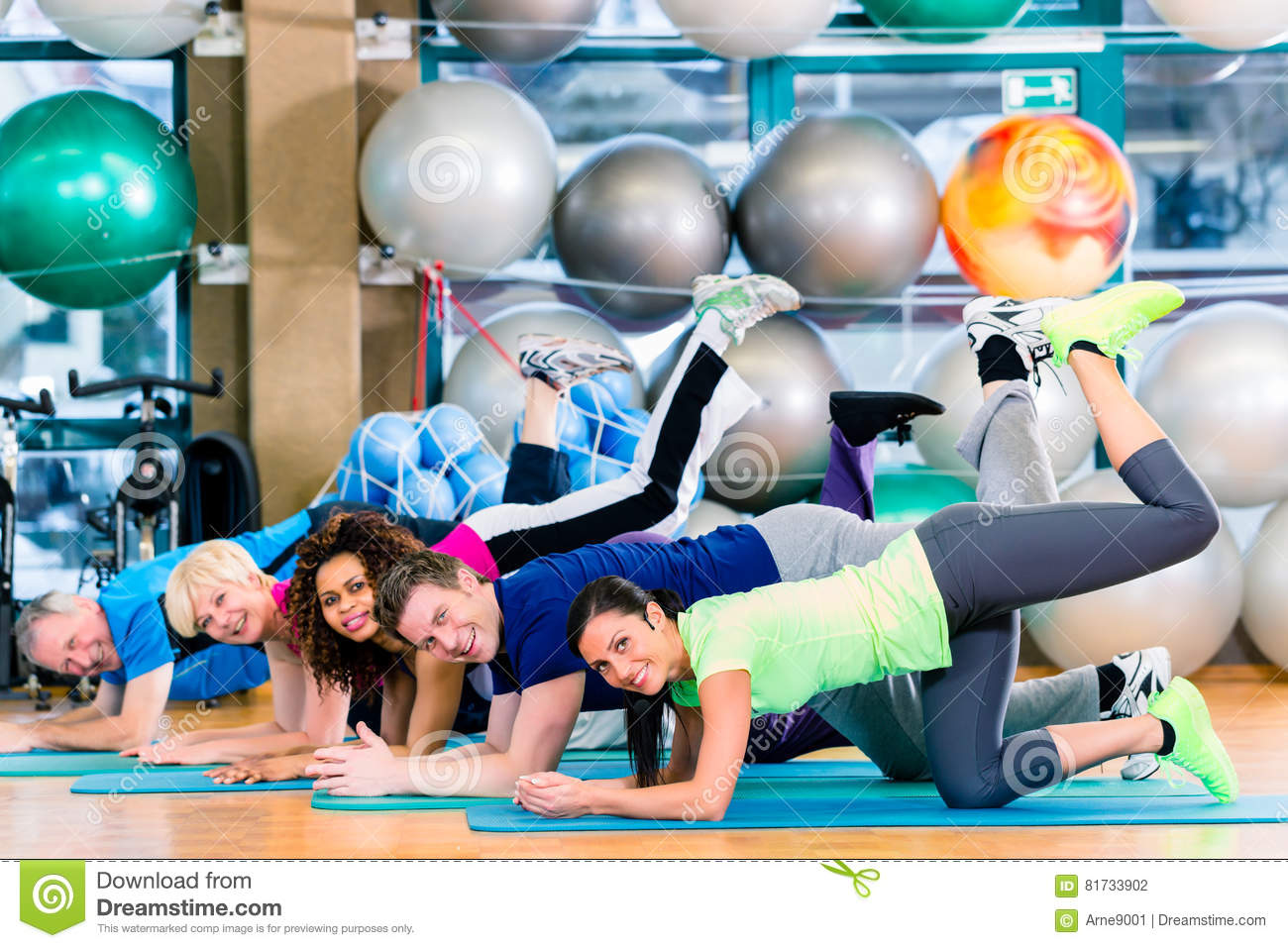 Gymnastic group in gym exercising and training