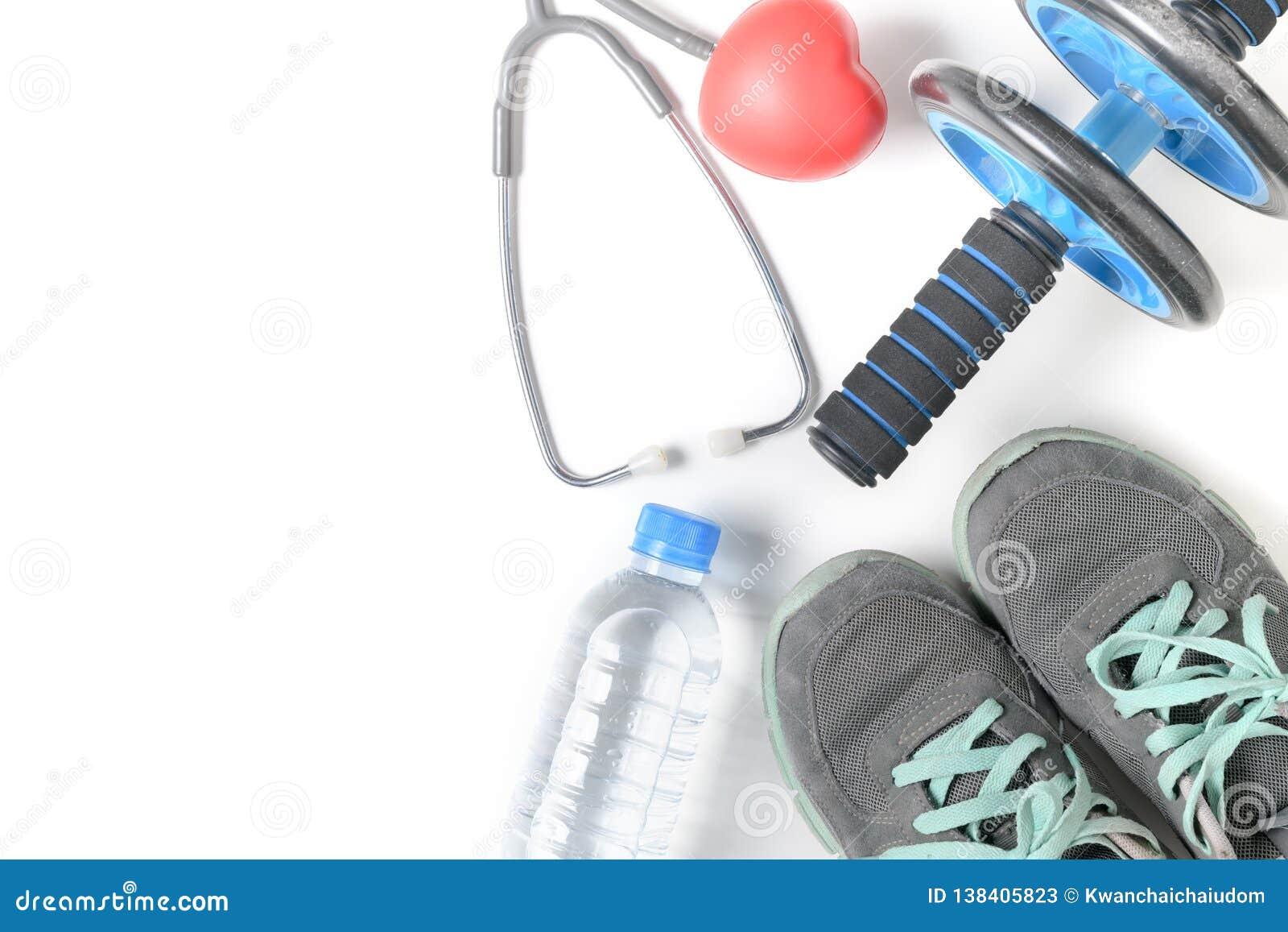 Gymnastikskor och konditionhjul med den isolerade stetoskopet