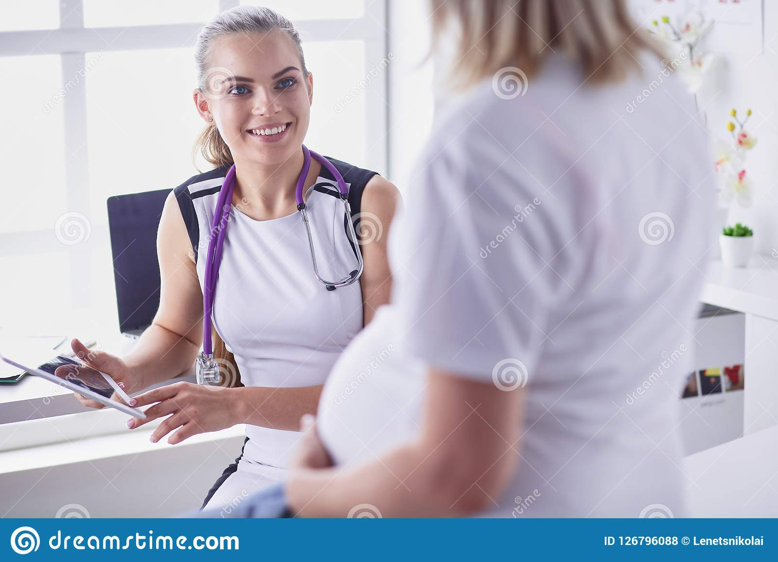 The Pregnant Woman Visiting Doctor For Consultation Stock