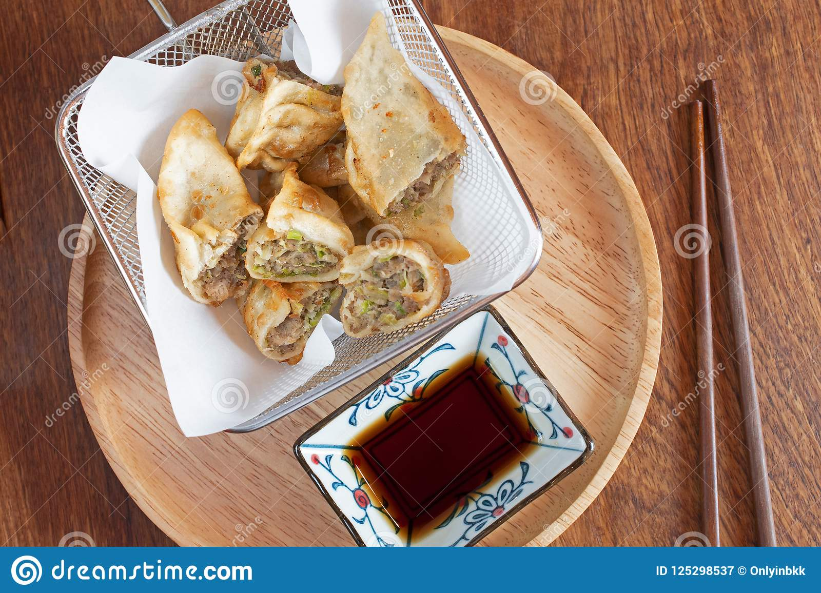 Chinese food shrimp and chicker fried roll snacks.