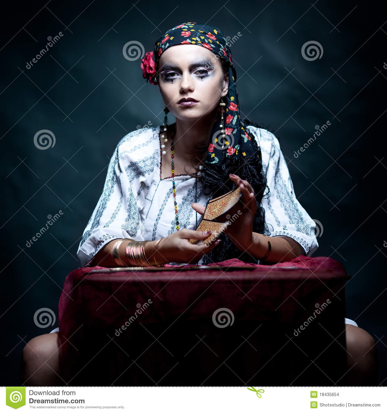 Gypsy fortune teller mixing the tarot cards.