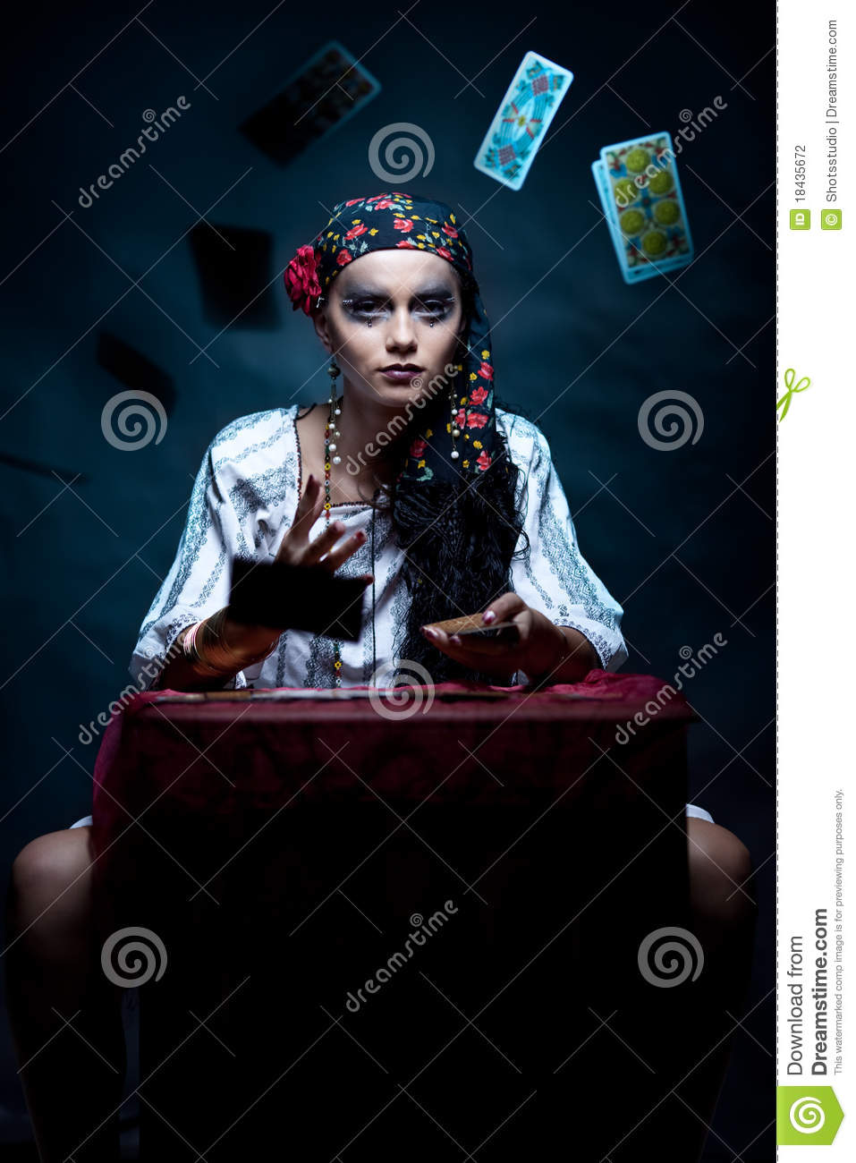 Gypsy fortune teller throwing the tarot cards.