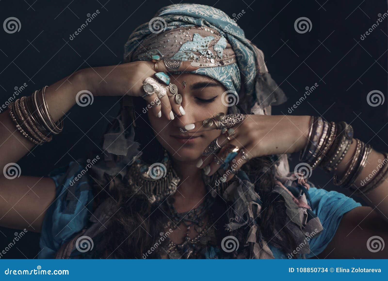 Gypsy style young woman wearing tribal jewellery portrait