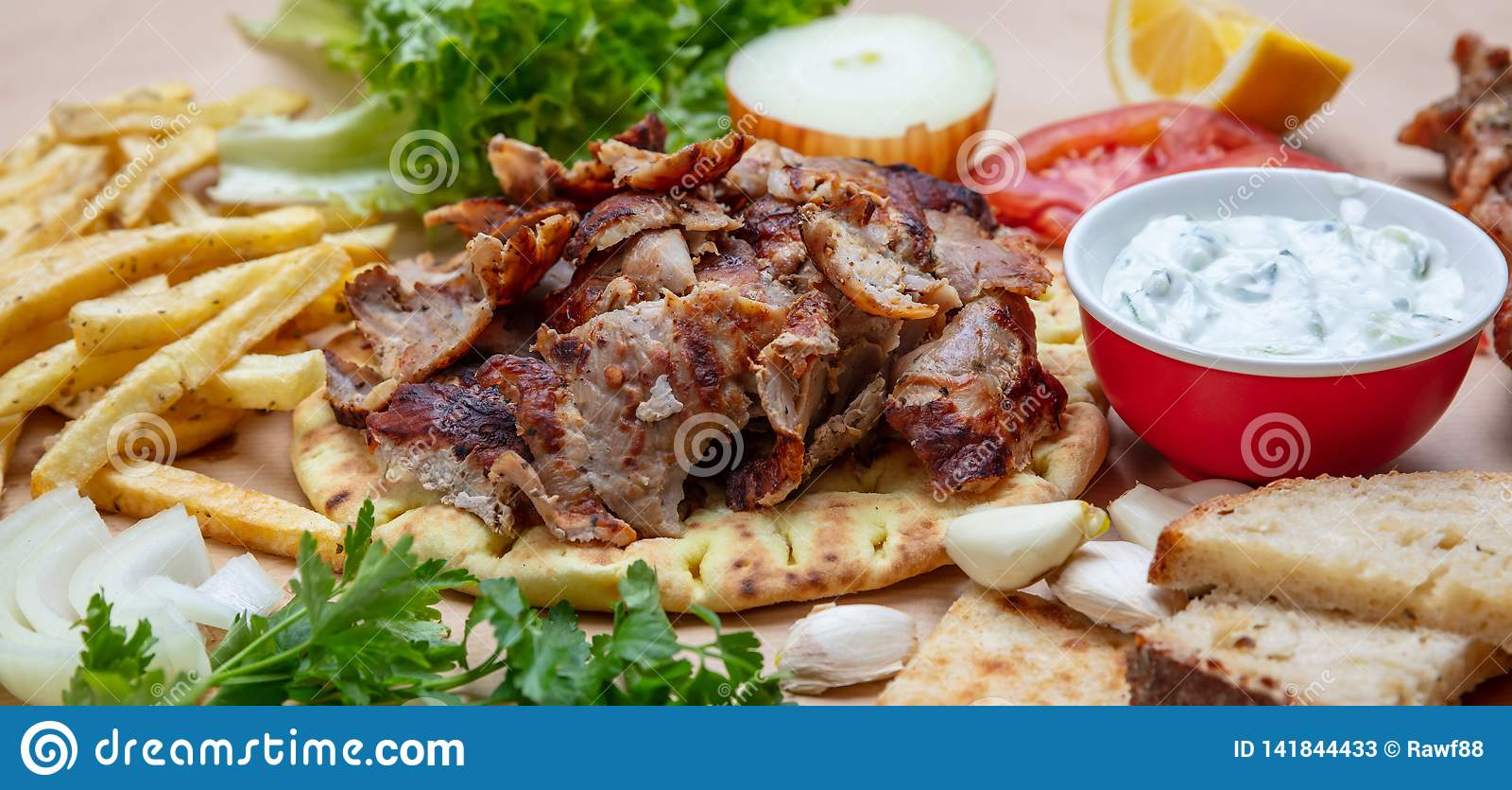 Gyros pita, Shawarma. Traditional greek, turkish meat food on pita bread and tzatziki, banner