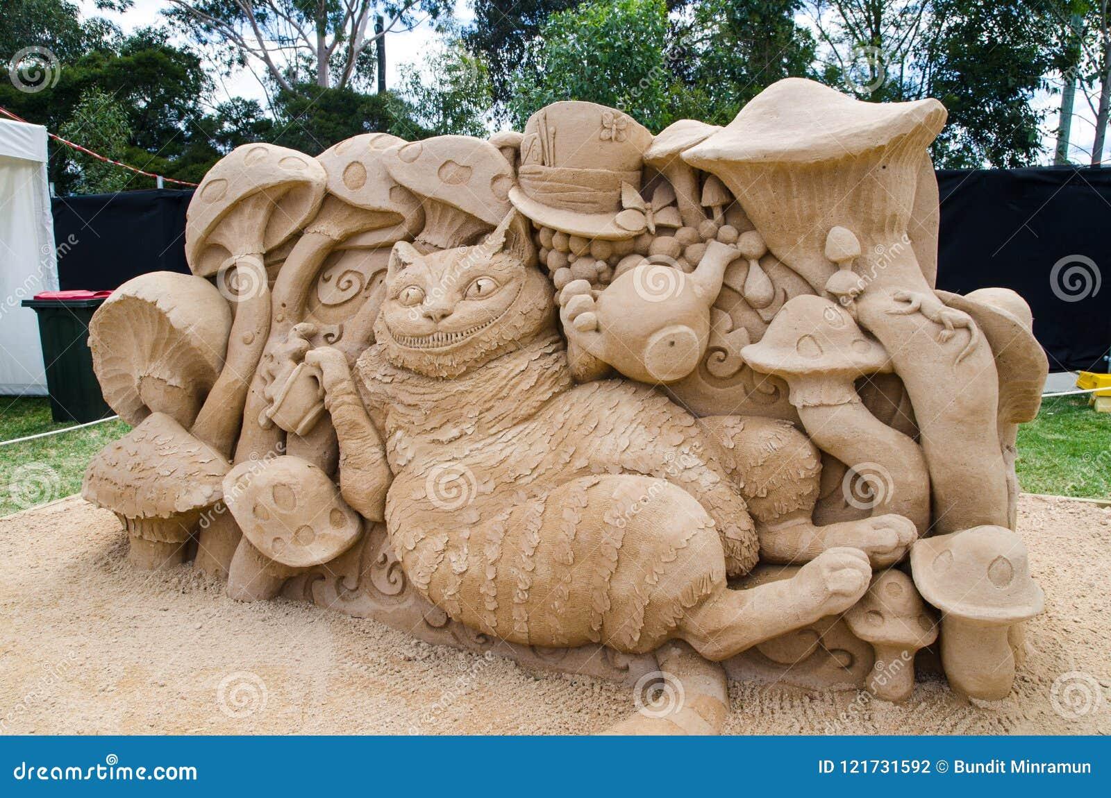 Härlig Cheshire Cat för sandskulptur` ` i underlandutställning, på Blacktown Showground