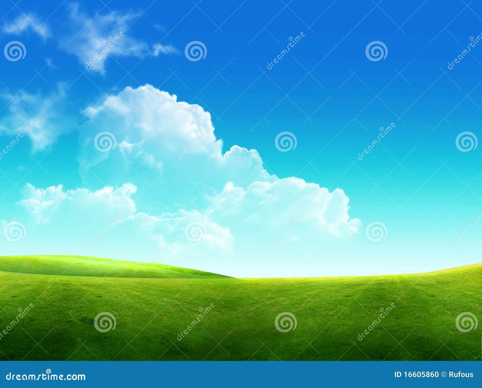 Härlig liggande, grönt gräs, blå sky