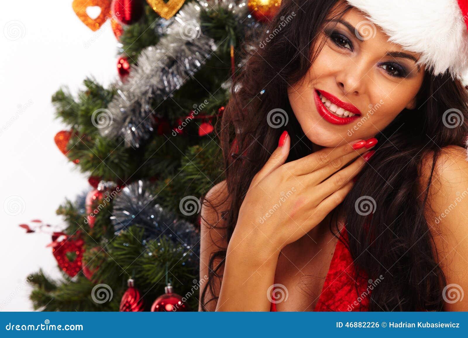 Härlig santa hjälpreda - bredvid julträd