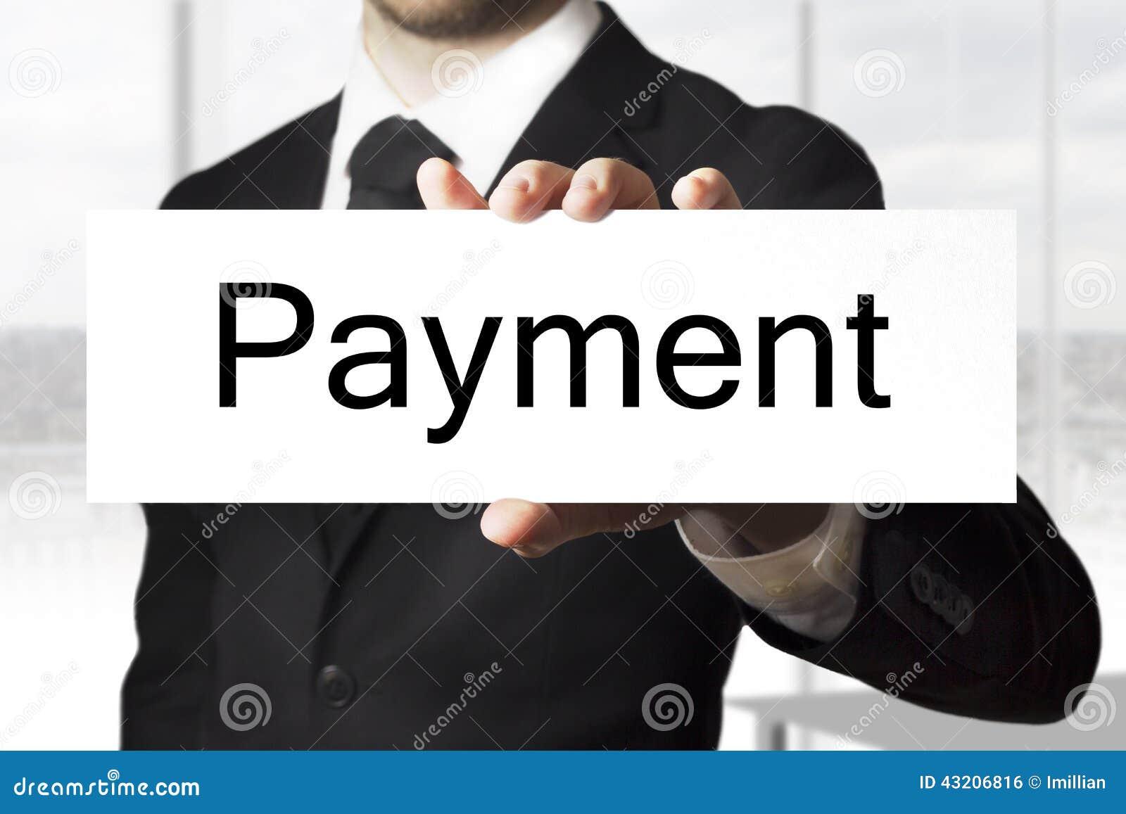 Download Hållande Teckenbetalning För Affärsman Arkivfoto - Bild av affärsman, internationellt: 43206816