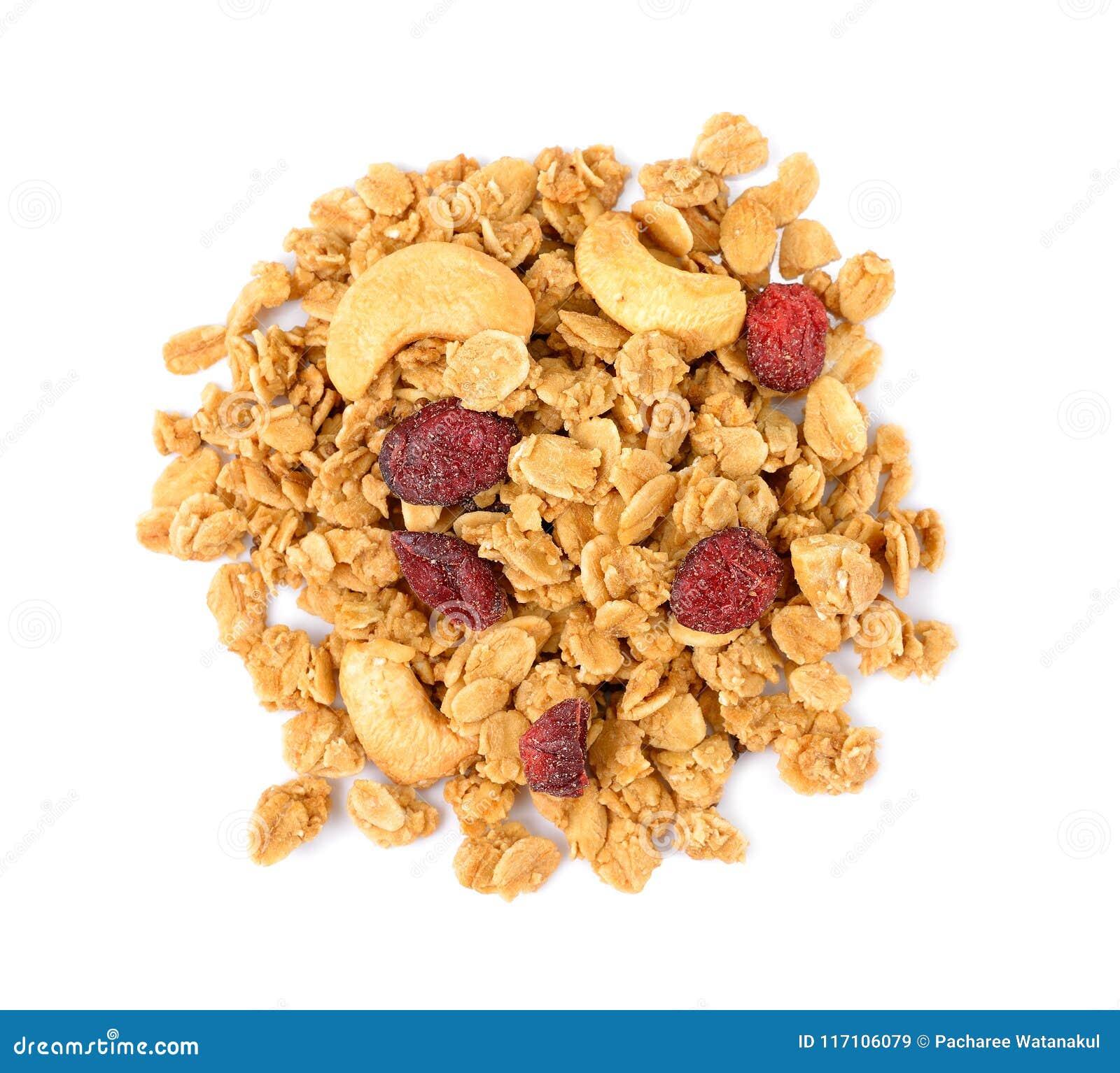Hög av granolasädesslag med kasjun som isoleras på vit