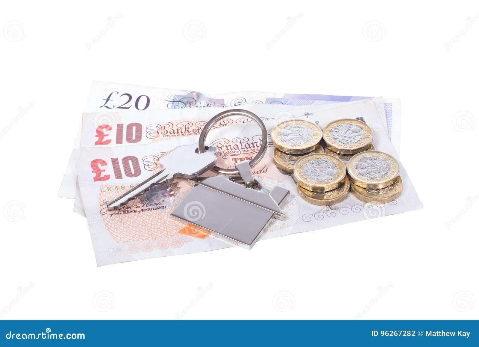 Hög av pengar med en hustangent på en etikett