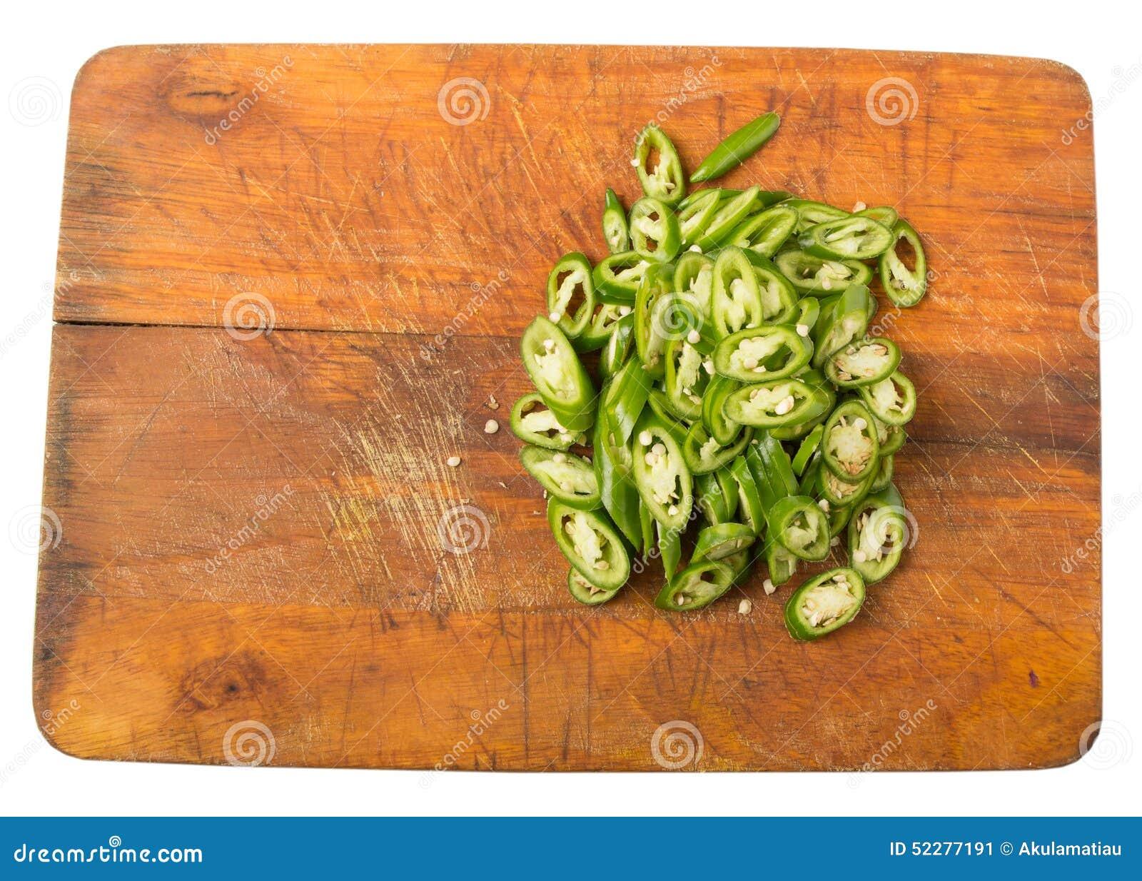 Högg av gröna Chili Peppers On Chopping Board III