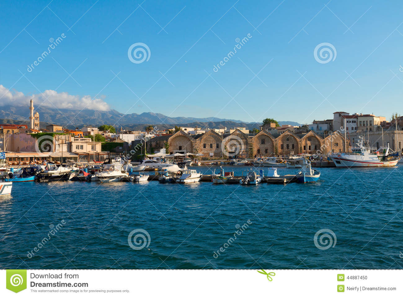 ... with historical houses and boats at sunny summer day, Crete, Greece