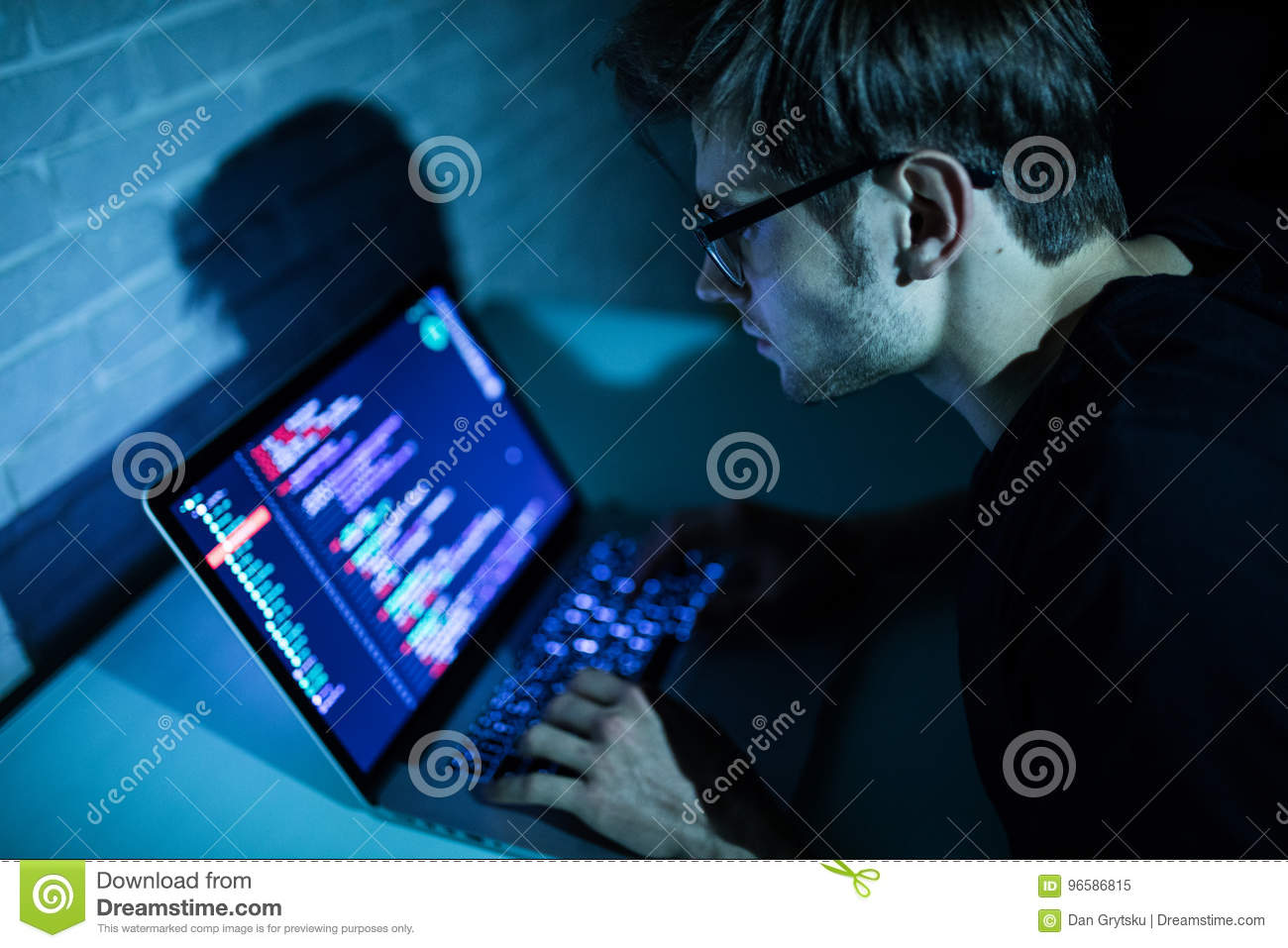 Hacker man trying to breach security of a computer system search internet